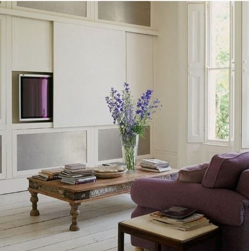 Sliding panel to hide a television in a sitting room scheme