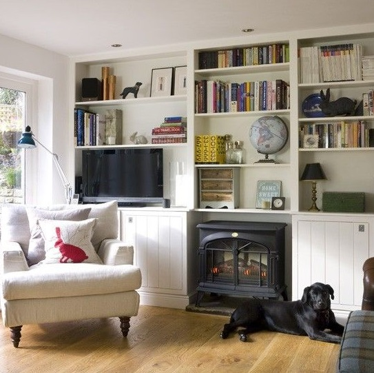 Using a wall unit to disguise a television in an interior design scheme