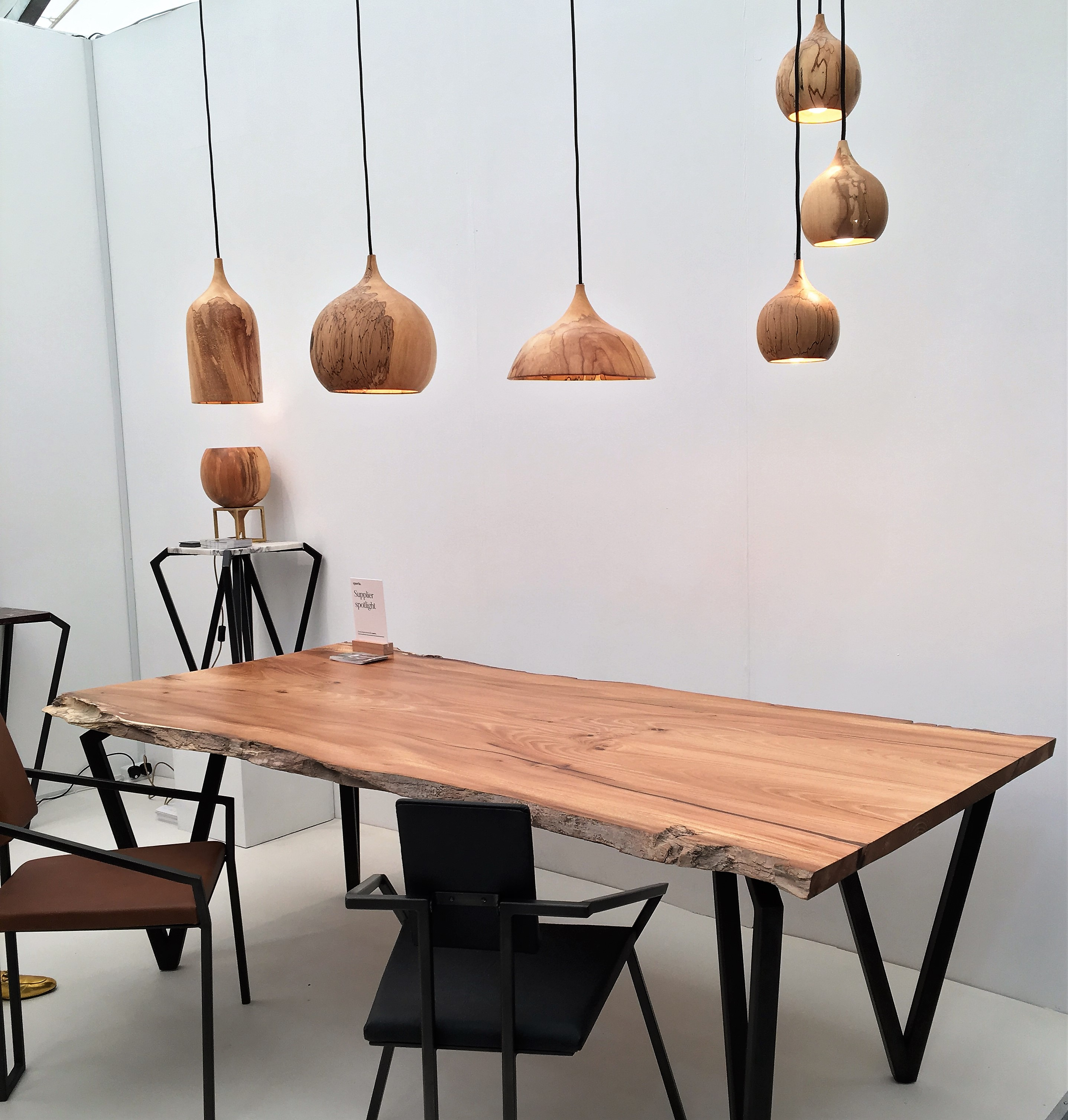 Wood and metal lights and table by Tamasine Osher Design
