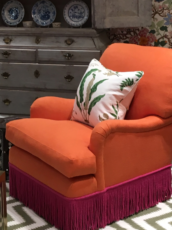 Orange armchair with hot pink fringe by Ben Pentreath for G P and J Baker
