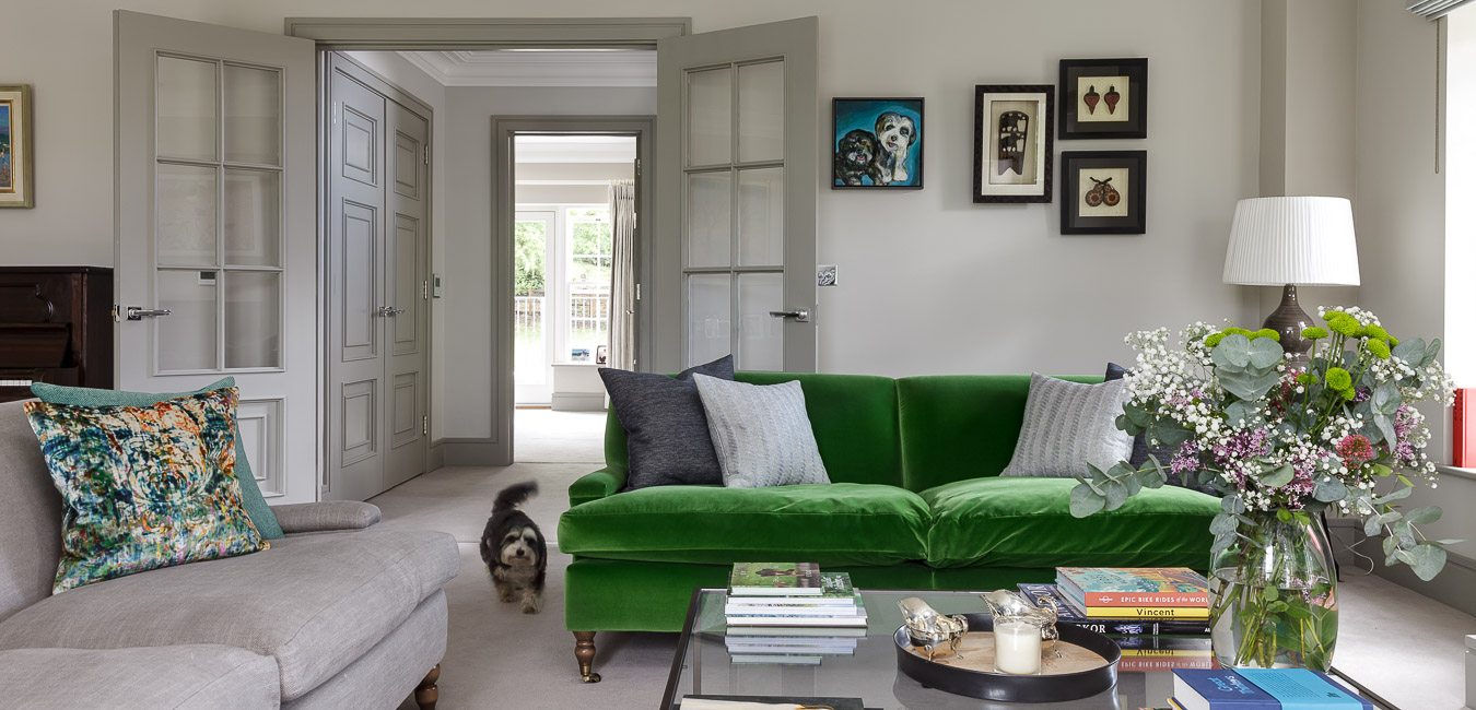 House and garden green sofa in a modern townhouse in Cobham in Surrey