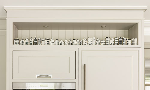 Decorative KLM dutch houses in a modern kitchen design by Hilary White Interiors